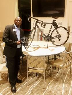 Edwin Robinson from Turning Points accepts to donation of a road bike from Del Webb AVMS