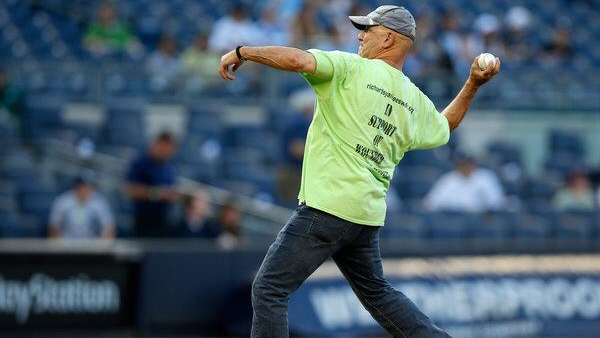 Richard Albero throws out the first pitch at Yankee Stadium after completing his 1,200 mile walk