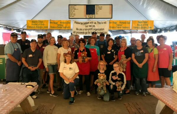 Del Webb veterans group volunteers supporting  scholarship fundraiser.