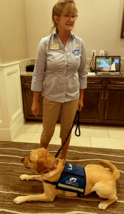 Karen Conkel and ambassador dog Levi at Del Webb AVMS April 2019 meeting.