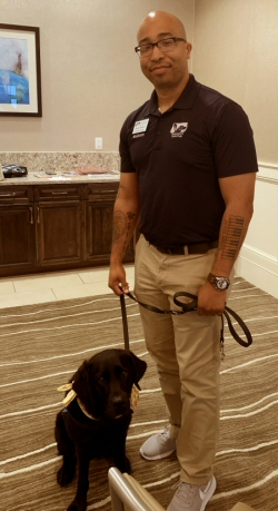 Veteran Sean Brown and service dog Pella from Southeastern Guide Dogs at Del Webb AVMS April 2019 meeting.